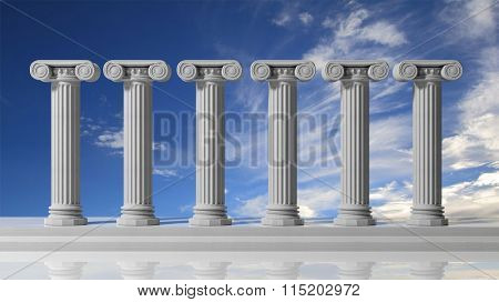 Six ancient pillars with bluet sky background. stock photo