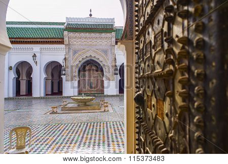 Entrance of the University al-Qarawiyyin or al-Karaouine. Fez El Bali Medina. Fez Morocco. North Africa. (focus in background)