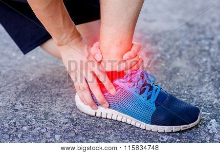 Runner Touching Painful Twisted Or Broken Ankle. Athlete Runner Training Accident. Sport Running Ank