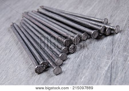 a bunch of metal nails on the alluminium scratched background stock photo