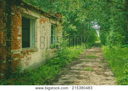 Abandoned interior in ruins of military settlement. The headquarters of the military unit stock photo