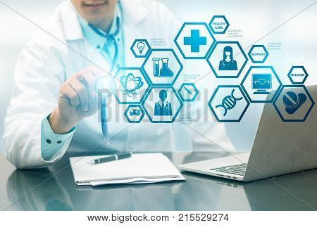 Medical Science Concept - Doctor in hospital lab with medical research icons in modern interface showing symbol of medicine innovation medical treatment discovery and doctoral analysis. stock photo