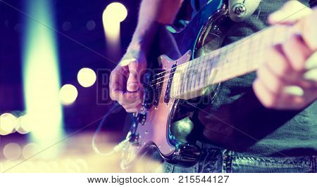 Live music background.Concert and music festival.Instrument on stage and band.Stage lights.Abstract musical background.Playing guitar and concert concept