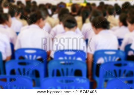blur education of student sit chair plastic blue in seminar the lecture room with copy space add text