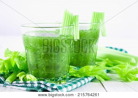 Vegetable cocktail made from celery leaves healthy lifestyle on a white wooden background stock photo