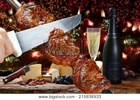 Delicious barbecue of picanha celebrating the end of the year with fireworks and champnhe stock photo