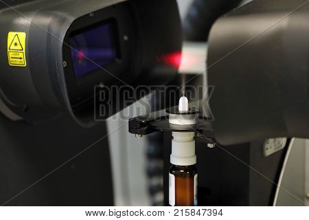 The worker measures the size of the particles and drops of the spray. Pharmaceutical industry and laboratory. Measurement of particle size with a laser. Malvern spraytec. Spray for the nose. Production of pharmaceutical sprays stock photo