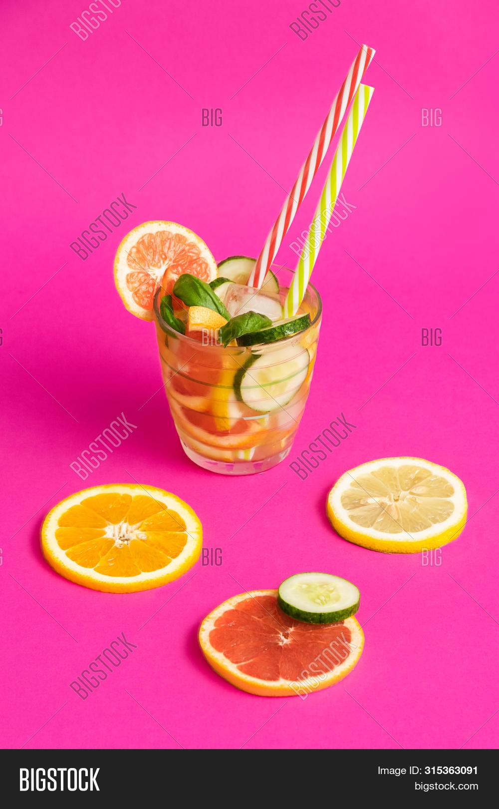 background,balance,citrus,citruses,closeup,cocktail,color,colorful,copy,creative,cucumber,detox,detoxification,diet,drink,fancy,flat,food,freshness,fruit,fuchsia,glass,grapefruit,healthy,homemade,ideas,juicy,lay,lemon,lifestyles,macro,orange,organic,photography,preparation,raw,refreshing,seasonal,serving,slice,space,straw,studio,tasty,vegan,vegetarian,vibrant,vitamins,water,yellow