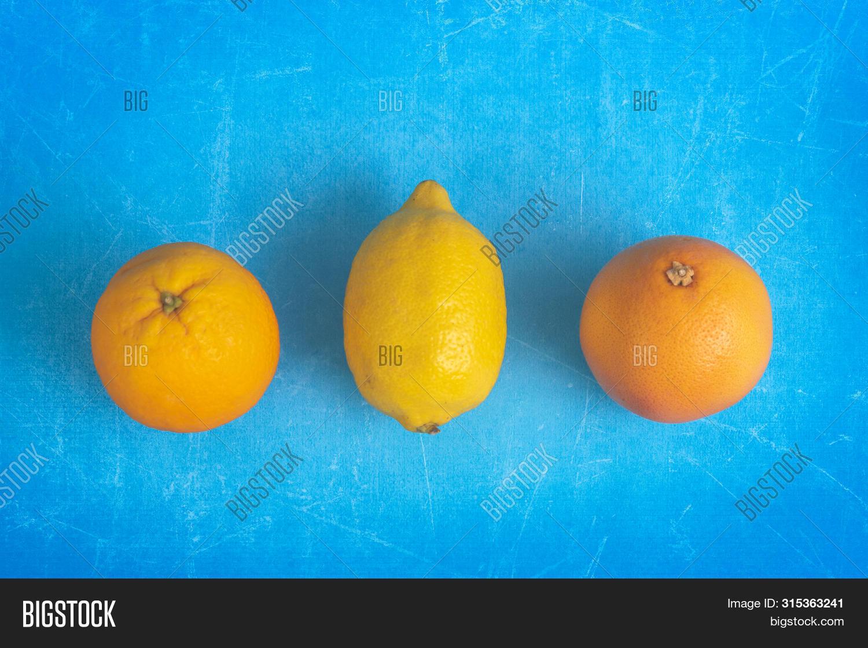 above,background,balance,blue,citrus,citruses,closeup,colorful,copy,creative,creativity,design,detox,detoxification,diet,drink,fancy,flat,food,freshness,fruit,funny,grapefruit,healthy,homemade,ideas,juicy,lay,lemon,lifestyles,macro,orange,organic,photography,preparation,raw,refreshing,seasonal,serving,space,studio,summer,tasty,vegan,vegetarian,vibrant,vitamins,yellow