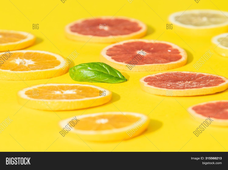 above,background,balance,basil,circle,citrus,citruses,closeup,colorful,copy,creative,creativity,design,detox,detoxification,diet,flat,food,freshness,fruit,grapefruit,healthy,homemade,ideas,juicy,lay,lemon,lifestyles,macro,orange,organic,photography,preparation,raw,red,refreshing,seasonal,serving,slice,sour,space,studio,summer,symmetric,tasty,vegan,vegetarian,vibrant,vitamins,yellow