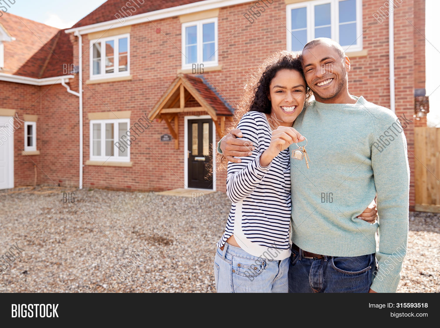30s,40s,african american,black,buying,couple,excitement,female,first time buyer,forties,front view,happy,help to buy,holding,home,horizontal,house,house buying,hug,hugging,key,key fob,key ring,looking at camera,male,man,men,mortgage,moving,moving day,moving in,new home,outdoors,people,person,portrait,property,real estate,rental,renting,smiling,thirties,together,two people,waist up,woman,women