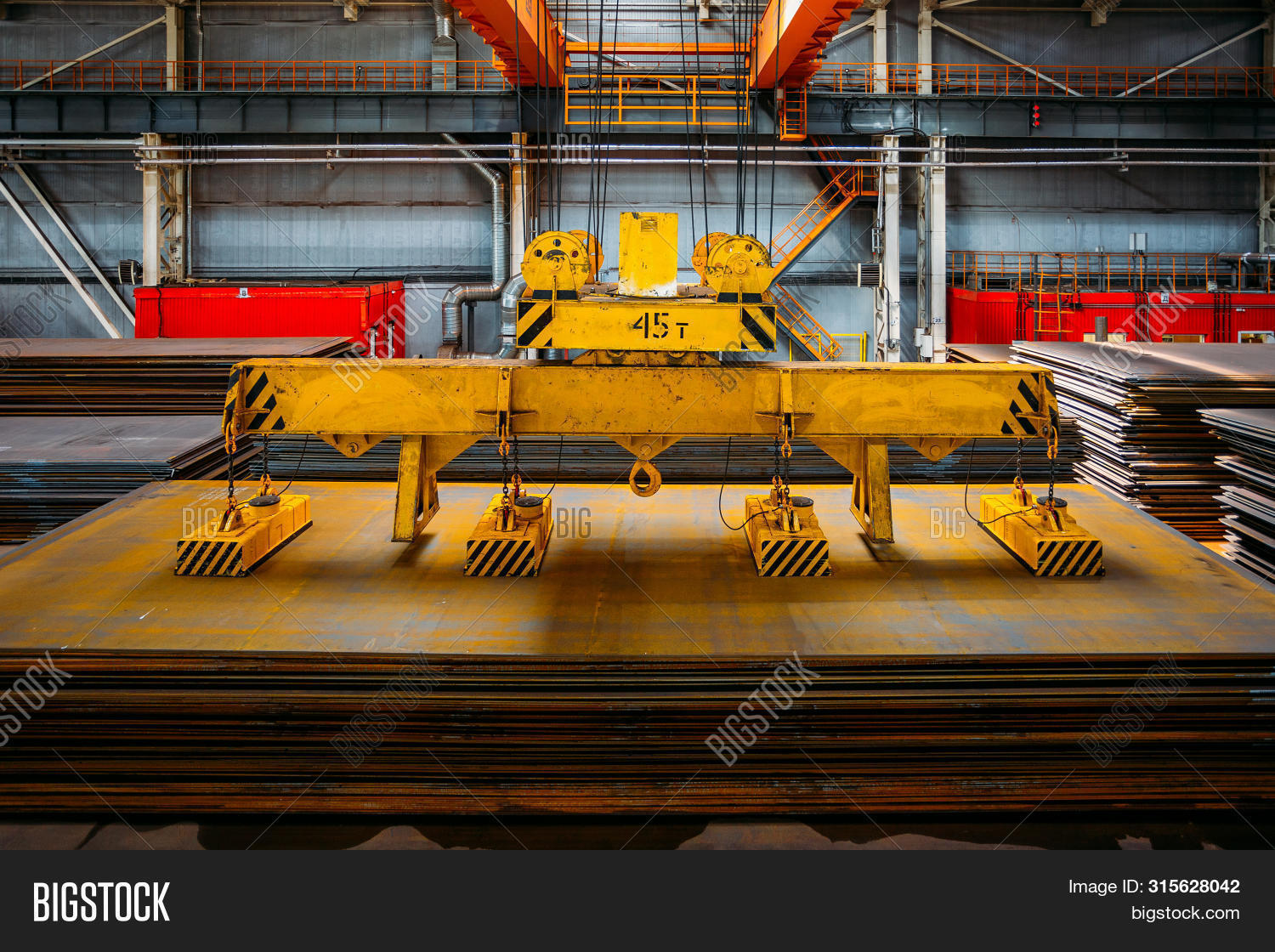 Overhead Crane With Electromagnetic Beam Grippers Lifting Steel Sheets.