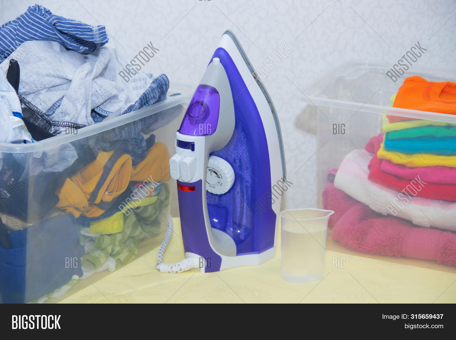 apparel,background,blue,board,bright,casual,clean,closeup,cloth,clothes,clothing,collection,color,colorful,concept,cotton,domestic,electric,equipment,fabric,folded,fresh,garment,group,heap,home,household,housework,indoors,iron,ironed,ironing,isolated,laundry,material,modern,nobody,organized,pile,press,shirts,stack,steam,style,table,textile,washed,wear,white