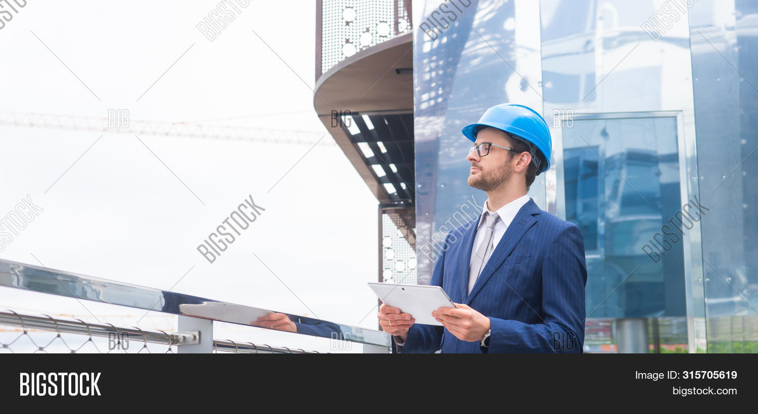 alone,architect,architects,balcony,bank,banking,boss,building,business,businessman,businessperson,career,city,collar,communication,company,concept,confident,construction,conversation,corporation,coworkers,crane,deal,development,financial,formalwear,future,helmet,inspecting,invest,job,mail,man,manager,market,modern,office,outdoor,outside,person,perspectives,professional,real estate,retailing,standing,talking,white,worker,young