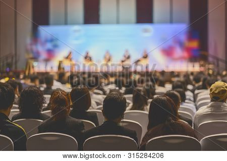Rear View Of Audience Listening Speakers On The Stage In The Conference Hall Or Seminar Meeting, Bus