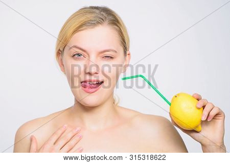 full energy. fresh fruit juice. energy and positive mood. girl with lemon charging. Recharge your body vitamins. lemon battery. woman with hobnail at lemon. vitamin diet food. skincare. healthy skin stock photo