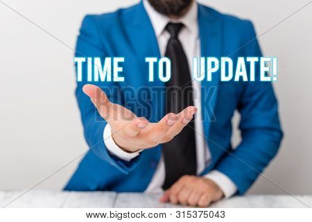 Text sign showing Time To Update. Conceptual photo act updating something someone or updated version program Man holds empty paper with copy space in front of him Copy Space. stock photo