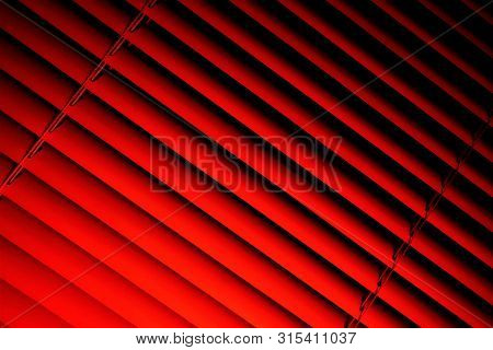 Blinds pink background--effective light protection devices from horizontal slats. Slats can be fixed or rotated, regulate light and air flow. Blinds are popular in residential, office and industrial premises. stock photo