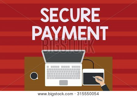 Text sign showing Secure Payment. Conceptual photo Security of Payment refers to ensure of paid even in dispute Upper view laptop wooden desk worker drawing tablet coffee cup office. stock photo