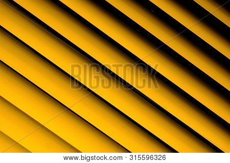 Blinds yellow background--effective light protection devices from horizontal slats. Lamellas are stationary, turn, regulate light, air flow. Blinds are popular in residential, office, industrial stock photo