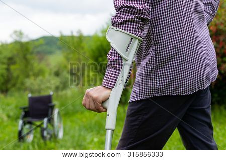 Picture of an elderly man walking with Assistive cane stock photo