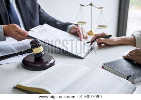 Businesswoman and Male lawyer or judge consult and conference having team meeting with client at law firm in office, Law and Legal services concept. stock photo