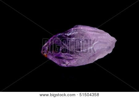 Sindle Amethyst Crystal isolated over black background stock photo