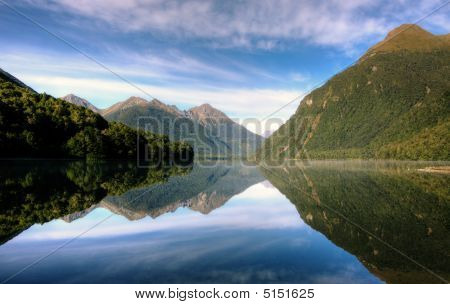 Mirror Lakes at Milford Sound on a clear day stock photo
