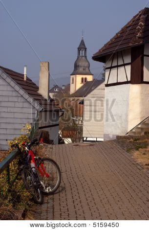 Modern bike in old German town belltower between traditional old houses town Heimbach Germany stock photo
