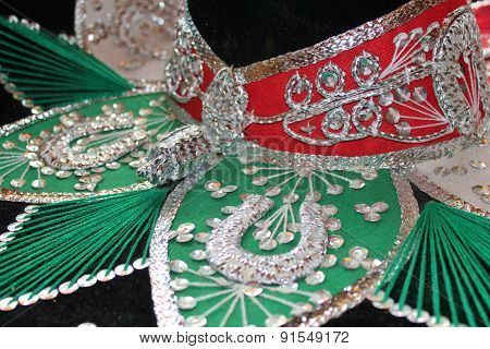 sequin and decorative ornate mexican hat ready for a fiesta with a gun stock photo
