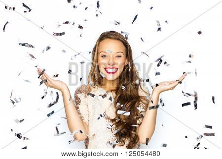 people, holidays, emotion and glamour concept - happy young woman or teen girl in fancy dress with s