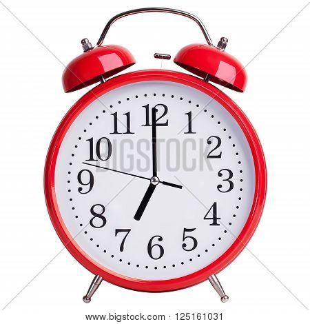 Red alarm clock shows exactly seven o'clock stock photo