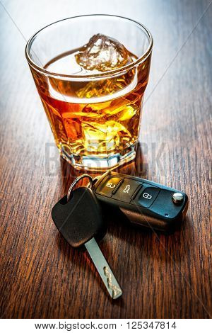 Whiskey with car keys concept for drinking and driving stock photo