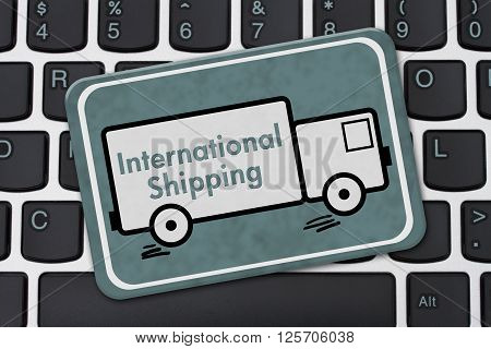 International Shipping Sign A teal hanging sign with text International Shipping on a truck on a keyboard