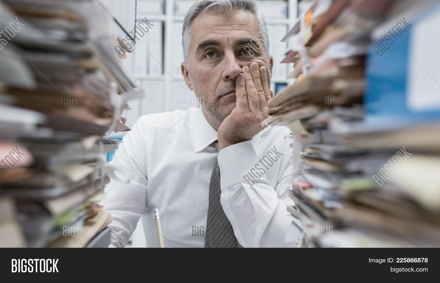 Frustrated Executive Overloaded With Paperwork