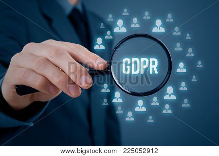 GDPR (general data protection regulation) concept. Businessman or IT technologist focus on GDPR problematics. Sensitive personal information represented by icons of people.