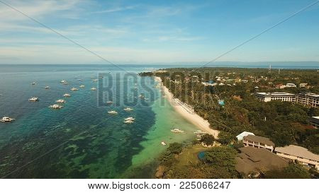 Aerial view of tropica Alona beach on the island Bohol, resort, hotels, Philippines. Beautiful tropical island with sand beach, palm trees. Tropical landscape. Seascape: Ocean, sky, sea. Travel concept. stock photo