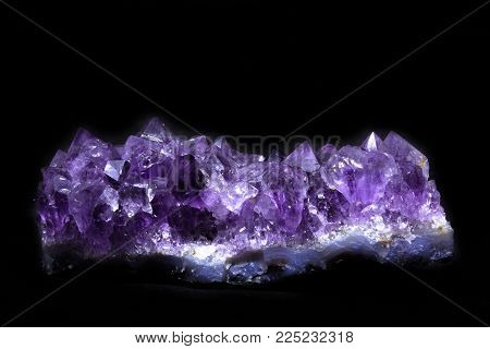 Natural Druse of amethyst on a black background front view stock photo