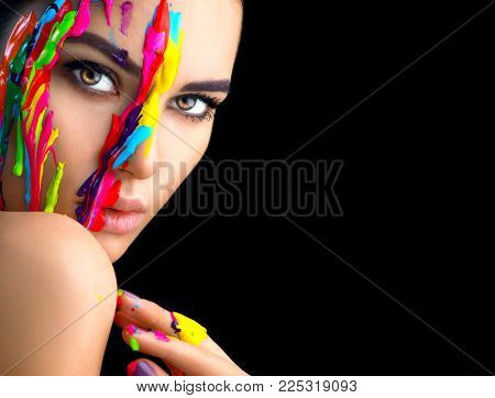 Fashion Model Girl colorful face paint. Beauty fashion art portrait of beautiful woman with flowing liquid paint, abstract makeup. Vivid paint make-up, bright colors. Vogue Multicolor creative make-up stock photo