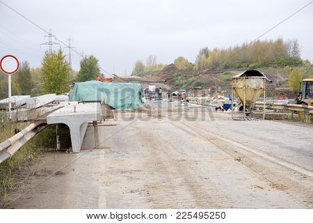 Road workers concrete the superstructure opposite heavy traffic stock photo