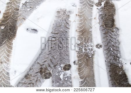 trace of the wheels on the snow as a background . stock photo