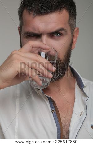 Bearded hipster drink water. Water consumption concept.   stock photo