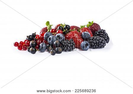 Set of fresh fruits and berries. Mix berries isolated on a white. Ripe blueberries, blackberries, currants and strawberries. Berries and fruits with copy space for text. Various fresh summer berries on white background. Background berries. stock photo