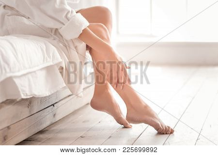 So beautiful. Close up of beautiful female legs while being taking care of after shower stock photo