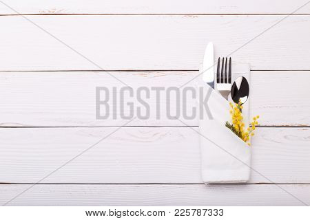 Spring table setting with mimosa. Holidays background with copy space stock photo