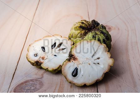 Sugar Apple (Annona squamosa L.) on wooden board, fruits of Thailand. stock photo