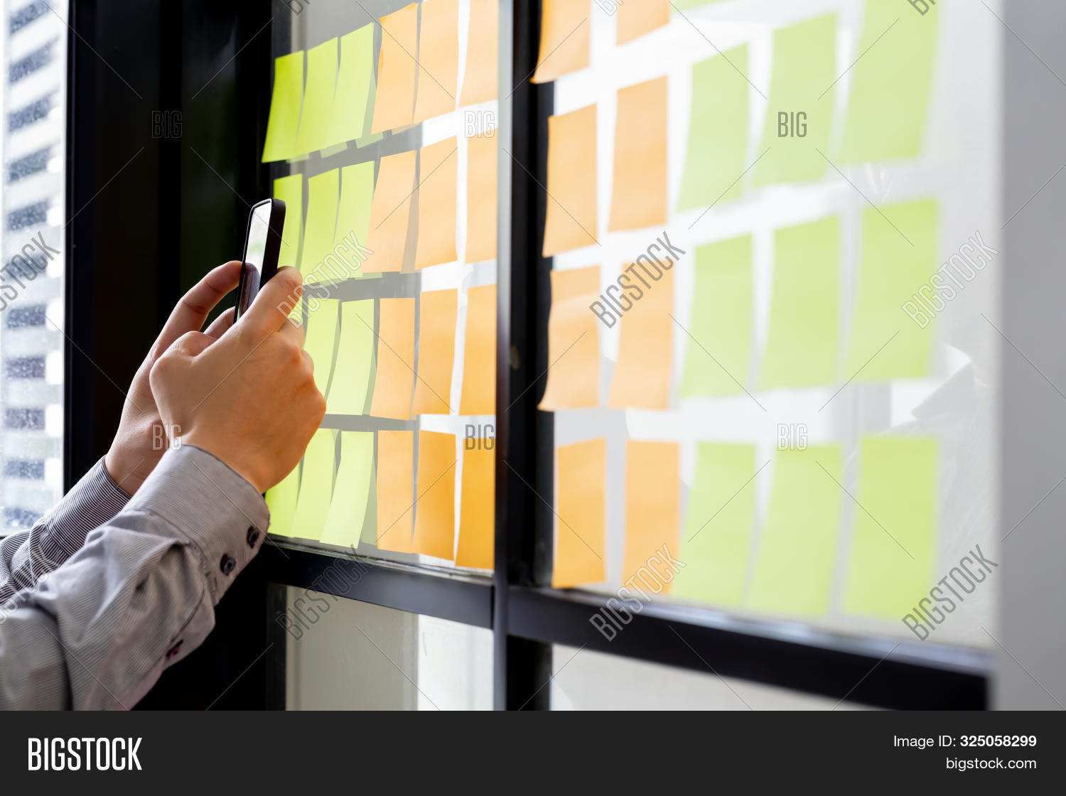It Worker Tracking His Tasks On Kanban Board In Mobile Phone Application. Using Task Control Of Agil
