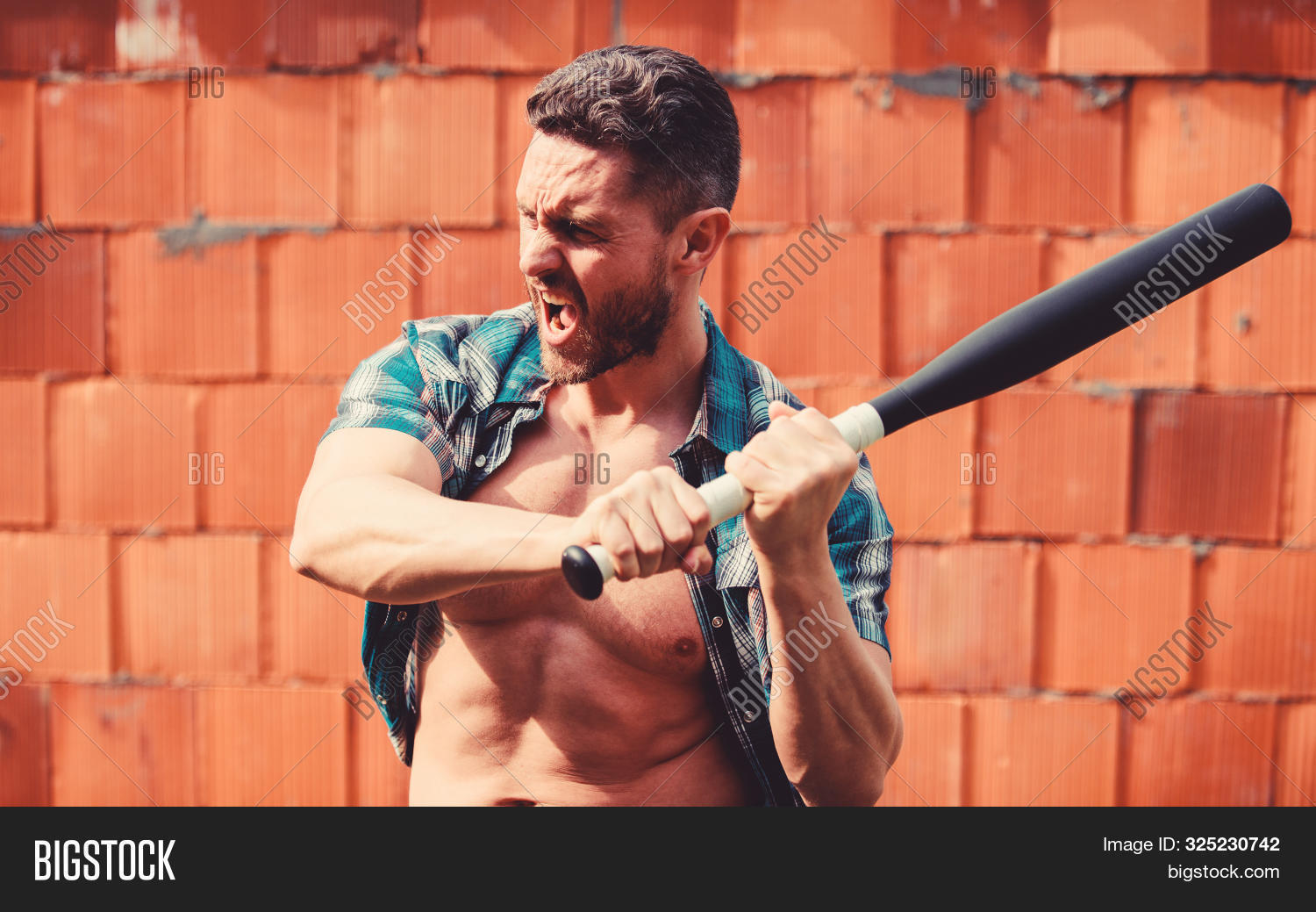 Feel my strength. Man unshaven face muscular torso hold black baseball bat. Strong temper. Confident his strength. Bully guy carry cudgel brick wall background. Power and strength. Attack concept