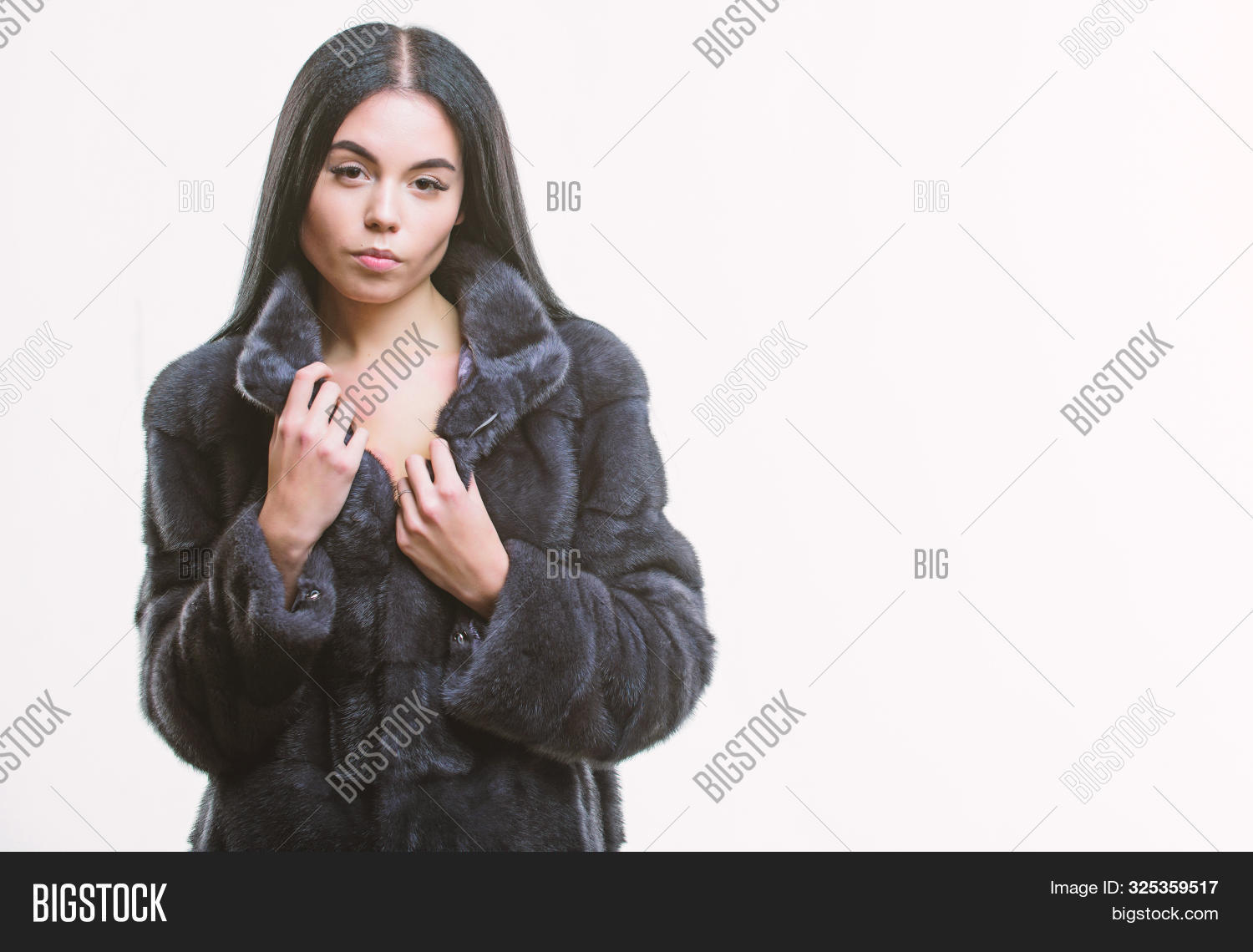 Girl elegant lady wear fashionable coat jacket. Luxurious fur. Girl posing fur coat. Woman attractive model wear dark soft coat. Fashion concept. Female with makeup wear mink black fur coat
