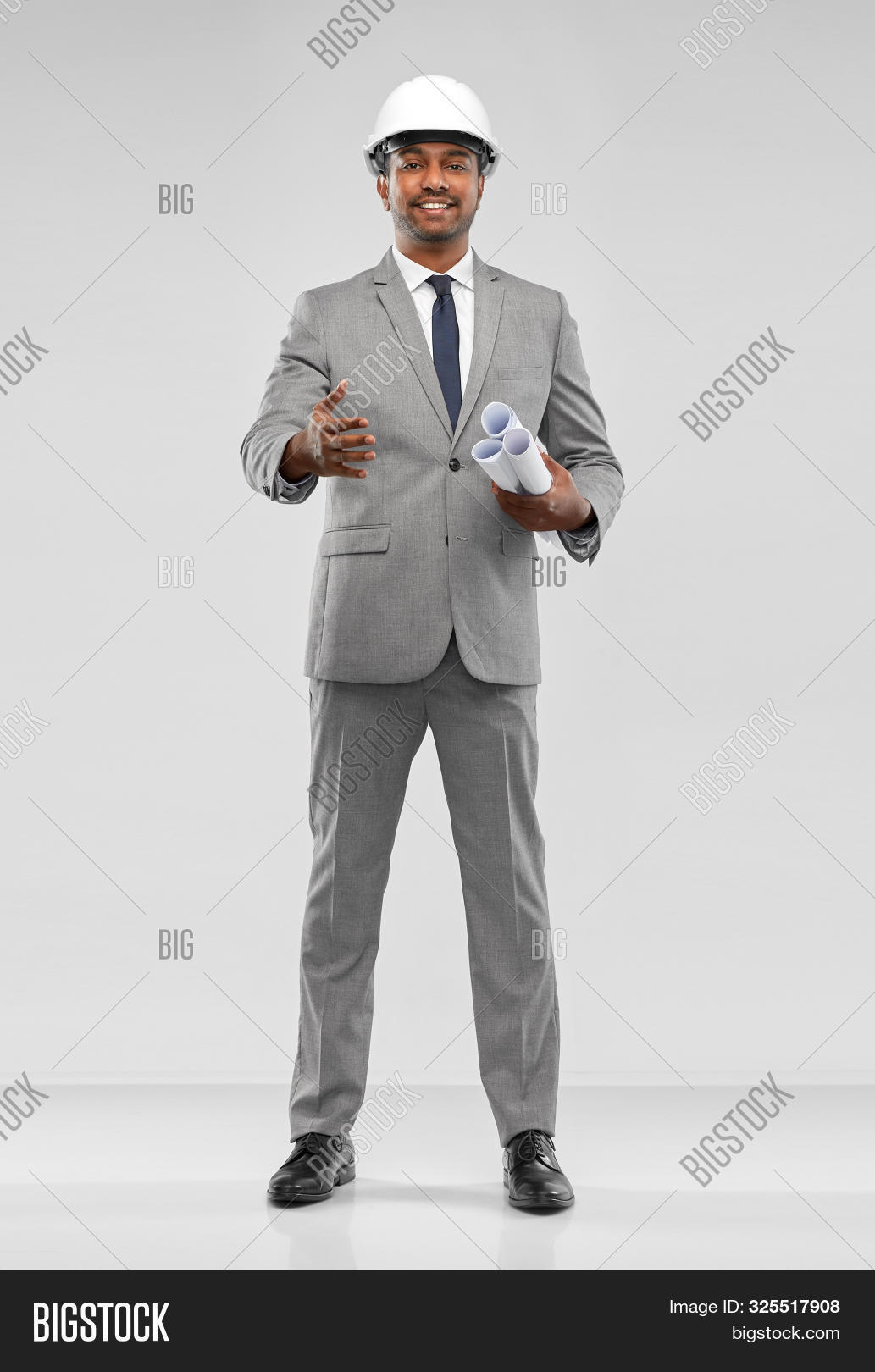 adult,agreement,architect,architecture,background,blueprint,building,business,businessman,cheerful,concept,construction,cooperation,corporate,deal,developer,entrepreneur,full-length,gesture,greeting,grey,hand,handshake,happy,hardhat,helmet,indian,male,man,office worker,partnership,people,person,professional,scroll,smiling,south asian,specialist,studio shot,suit,tie,white,white-collar,worker,young
